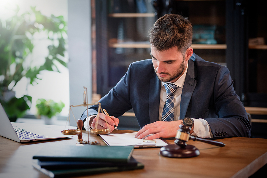 divorce lawyer in Sydney while working in his office