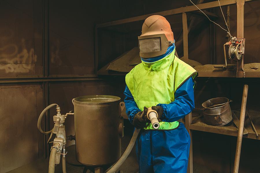 Employee preparing for concrete sandblasting process