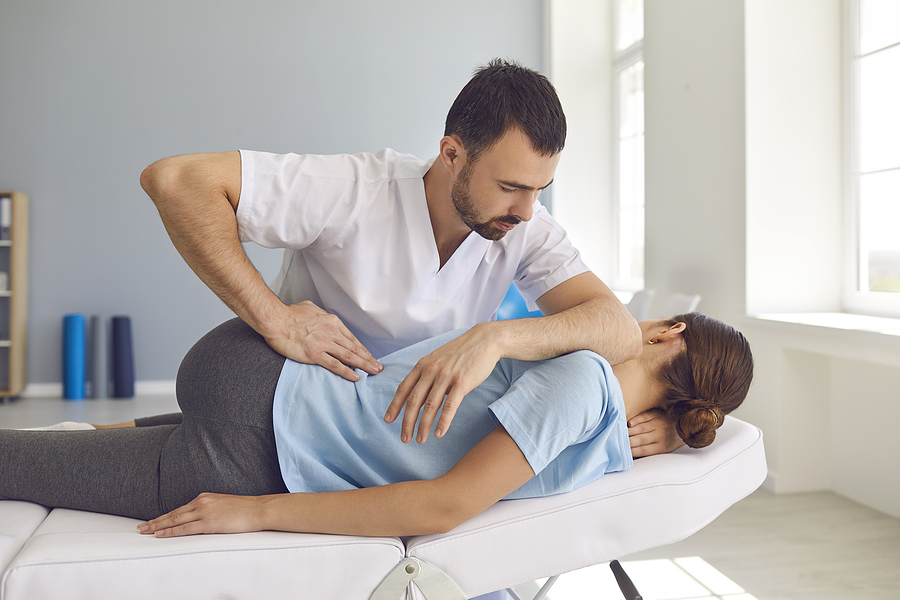Good Norwest chiropractor treating a female patient